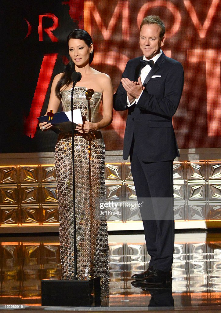 Actors Lucy Liu (L) and Kiefer Sutherland onstage during the 64th Primetime Emmy Awards at Nokia Theatre L.A. Live on September 23, 2012 in Los Angeles, California.