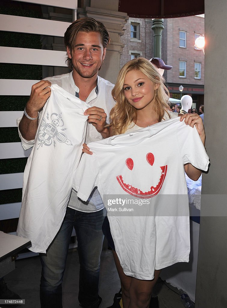 Actors Luke Benward (L) and <a gi-track='captionPersonalityLinkClicked' href=/galleries/search?phrase=Olivia+Holt&family=editorial&specificpeople=7563645 ng-click='$event.stopPropagation()'>Olivia Holt</a> attend Variety's Power of Youth presented by Hasbro, Inc. and generationOn at Universal Studios Backlot on July 27, 2013 in Universal City, California.