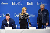 Actors Luke Evans Elisabeth Moss and producer Jeremy Thomas walk onstage during the 'HighRise' press conference at the 2015 Toronto International...