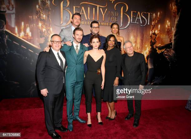 Actors Luke Evans Josh Gad and Gugu MbathaRaw Director Bill Condon Actors Dan Stevens Emma Watson Audra McDonald and Composer Alan Menken arrive for...