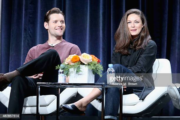 Actors Luke Kleintank and Alexa Davalos speak onstage during the 'The Man in the High Castle' panel discussion at the Amazon Studios portion of the...