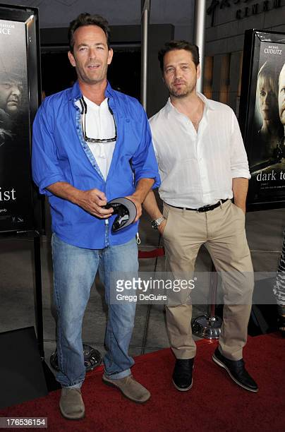 Actors Luke Perry and Jason Priestley arrive at the Los Angeles premiere of 'Dark Tourist' at ArcLight Hollywood on August 14 2013 in Hollywood...