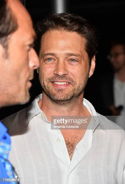 Actors Luke Perry and Jason Priestley arrive at the premiere of 'Dark Tourist' at ArcLight Hollywood on August 14 2013 in Hollywood California