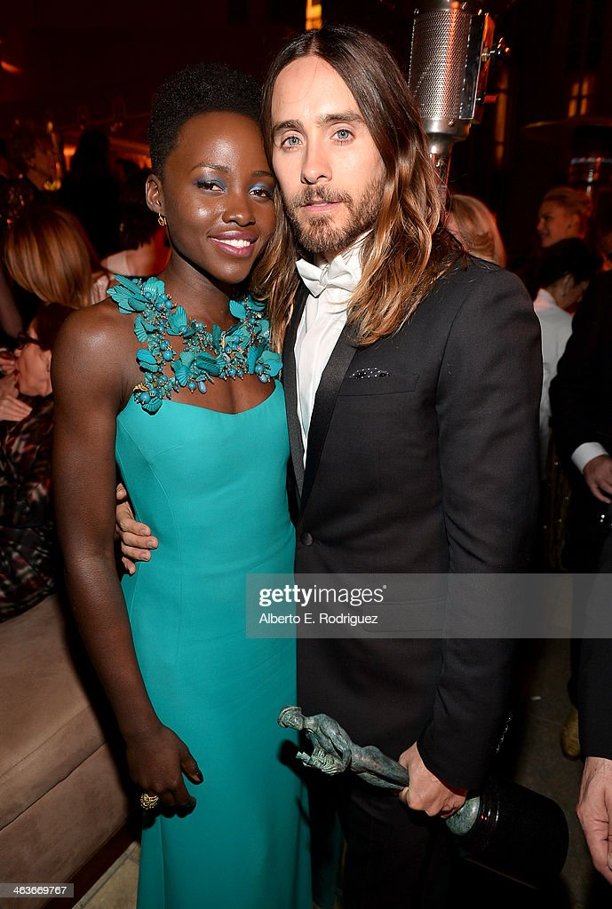 Actors <a gi-track='captionPersonalityLinkClicked' href=/galleries/search?phrase=Lupita+Nyong%27o&family=editorial&specificpeople=10961876 ng-click='$event.stopPropagation()'>Lupita Nyong'o</a> (L) and <a gi-track='captionPersonalityLinkClicked' href=/galleries/search?phrase=Jared+Leto&family=editorial&specificpeople=214764 ng-click='$event.stopPropagation()'>Jared Leto</a> attend the Weinstein Company & Netflix's 2014 SAG after party in partnership with Laura Mercier at Sunset Tower on January 18, 2014 in West Hollywood, California.