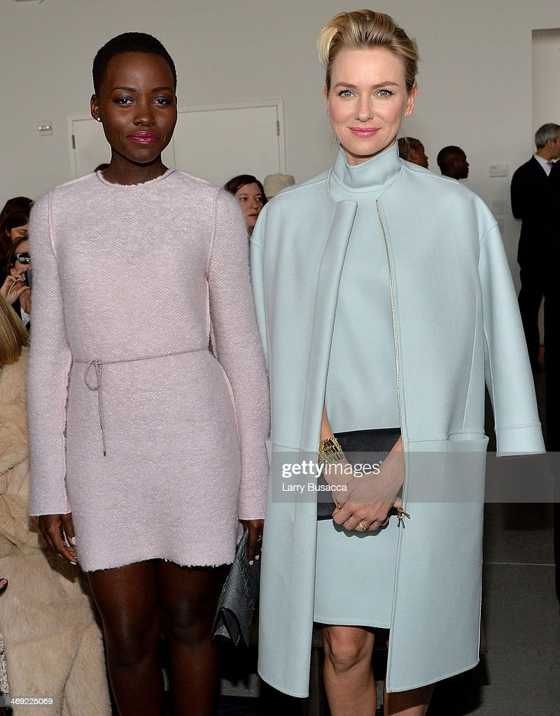 Actors <a gi-track='captionPersonalityLinkClicked' href=/galleries/search?phrase=Lupita+Nyong%27o&family=editorial&specificpeople=10961876 ng-click='$event.stopPropagation()'>Lupita Nyong'o</a> (L) and <a gi-track='captionPersonalityLinkClicked' href=/galleries/search?phrase=Naomi+Watts&family=editorial&specificpeople=171723 ng-click='$event.stopPropagation()'>Naomi Watts</a> attend the Calvin Klein Collection fashion show during Mercedes-Benz Fashion Week Fall 2014 at Spring Studios on February 13, 2014 in New York City.
