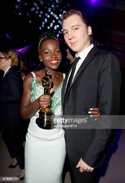 Actors Lupita Nyong'o and Paul Dano attend the 2014 Vanity Fair Oscar Party Hosted By Graydon Carter on March 2 2014 in West Hollywood California