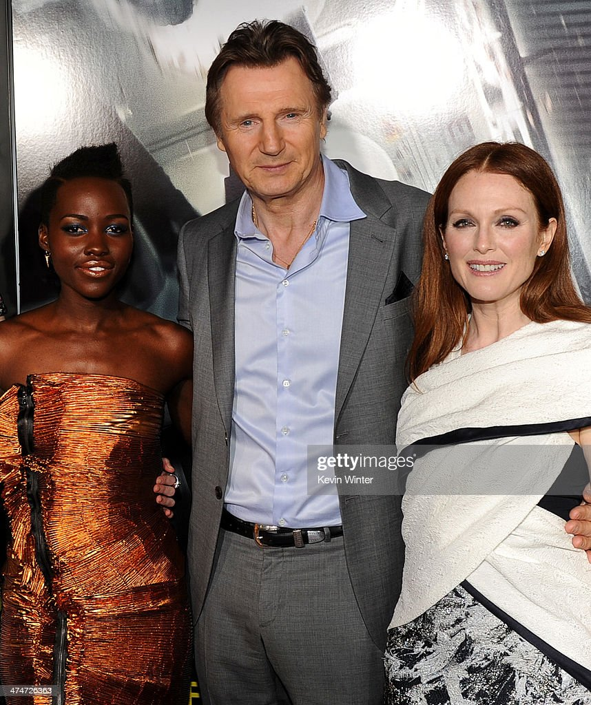 Actors Lupita Nyong'o, Liam Neeson and Julianne Moore attend the premiere of Universal Pictures and Studiocanal's 'Non-Stop' at Regency Village Theatre on February 24, 2014 in Westwood, California.