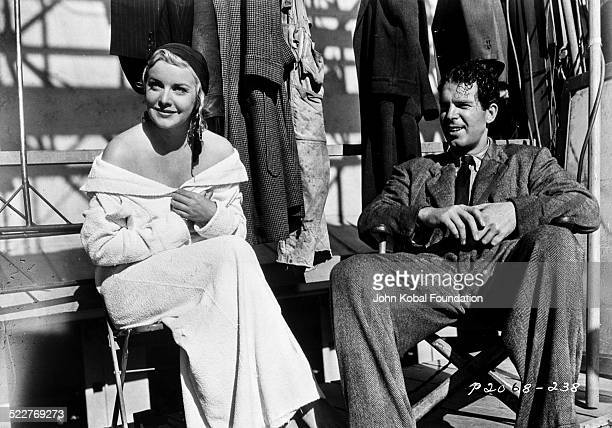 Actors Madeleine Carroll and Fred MacMurray resting between takes on the set of a movie with Paramount Pictures 1939