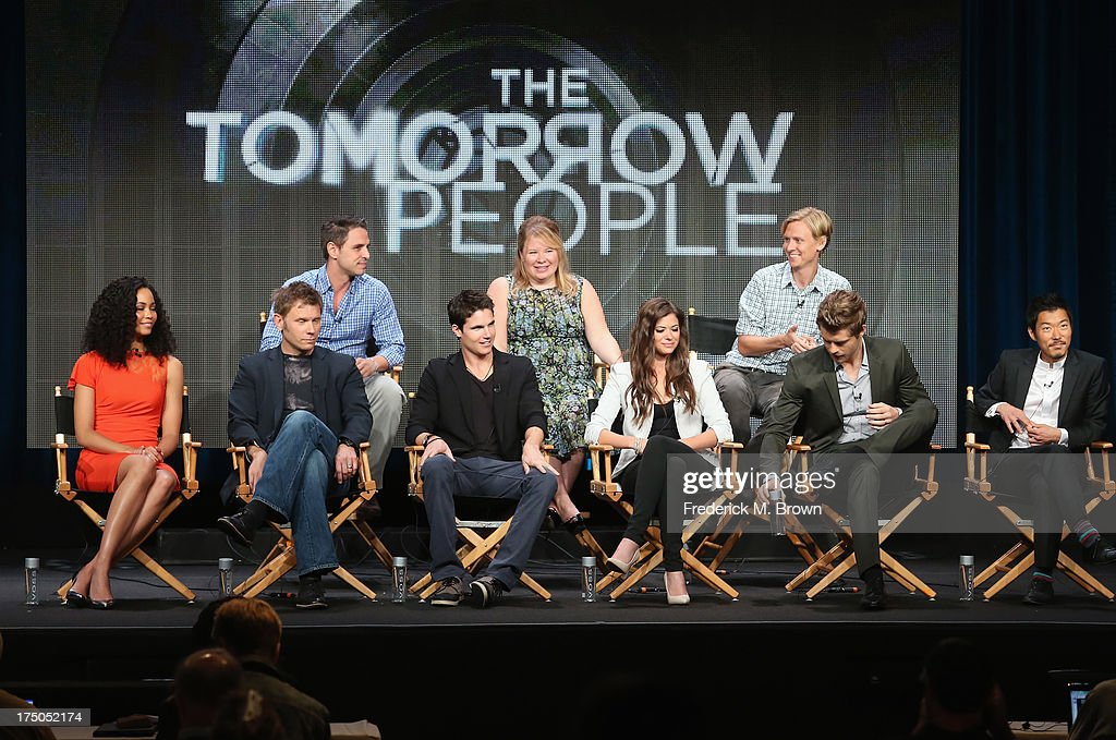 Actors Madeleine Mantock, Mark Pellegrino, <a gi-track='captionPersonalityLinkClicked' href=/galleries/search?phrase=Robbie+Amell&family=editorial&specificpeople=4601097 ng-click='$event.stopPropagation()'>Robbie Amell</a>, Peyton List, Luke Mitchell and <a gi-track='captionPersonalityLinkClicked' href=/galleries/search?phrase=Aaron+Yoo&family=editorial&specificpeople=4116413 ng-click='$event.stopPropagation()'>Aaron Yoo</a>, (back row L-R) executive producers <a gi-track='captionPersonalityLinkClicked' href=/galleries/search?phrase=Greg+Berlanti&family=editorial&specificpeople=2985318 ng-click='$event.stopPropagation()'>Greg Berlanti</a>, Julie Plec and Phil Klemmer speak onstage during 'The Tomorrow People' panel discussion at the CBS, Showtime and The CW portion of the 2013 Summer Television Critics Association tour at the Beverly Hilton Hotel on July 30, 2013 in Beverly Hills, California.