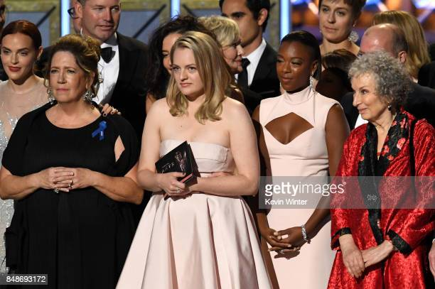 Actors Madeline Brewer Ann Dowd Elisabeth Moss and Samira Wiley and author Margaret Atwood with cast and crew of 'The Handmaid's Tale' accept the...