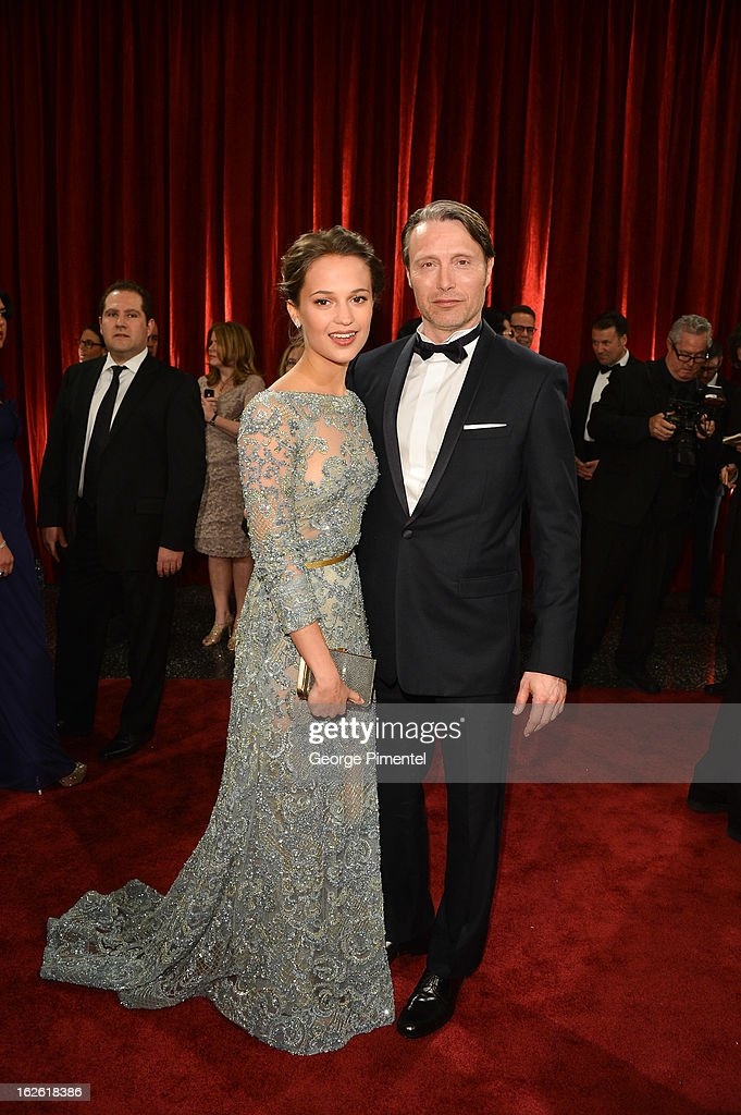 Actors Mads Mikkelsen and Alicia Vikander arrive arrive at the Oscars at Hollywood & Highland Center on February 24, 2013 in Hollywood, California. at Hollywood & Highland Center on February 24, 2013 in Hollywood, California.