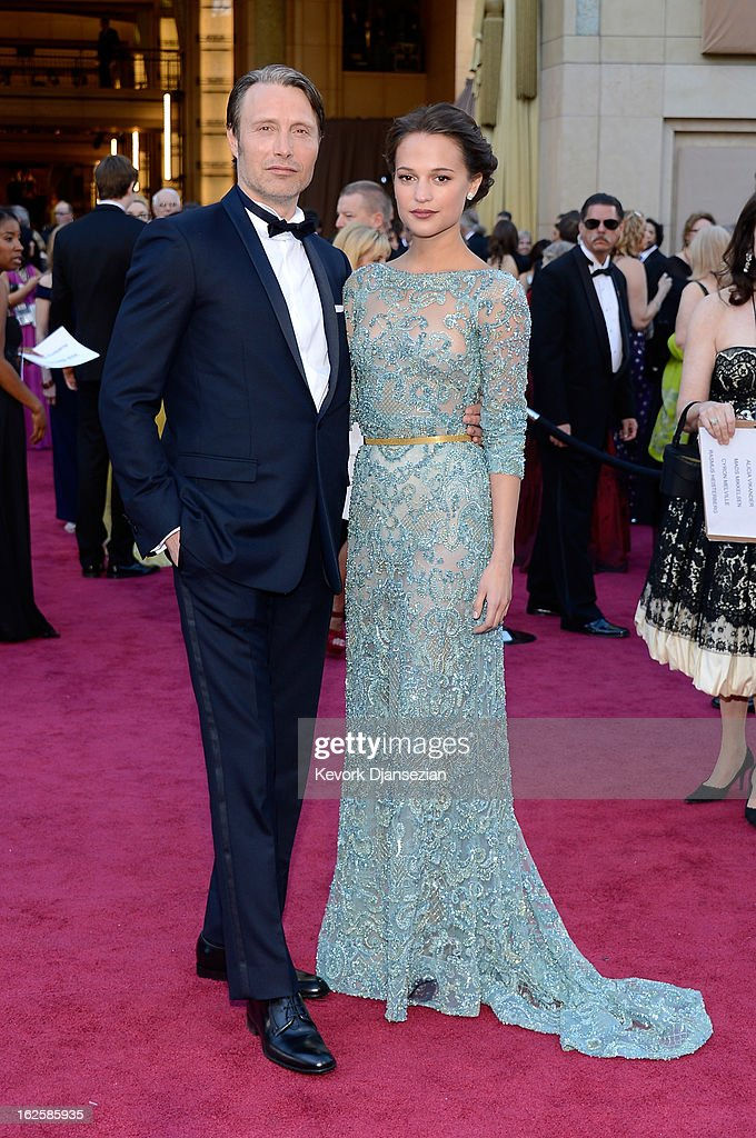 Actors Mads Mikkelsen and Alicia Vikander arrive at the Oscars at Hollywood & Highland Center on February 24, 2013 in Hollywood, California.