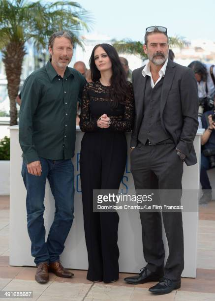 Actors Mads Mikkelsen Eva Green and Jeffrey Dean Morgan attend 'The Salvation photocall at the 67th Annual Cannes Film Festival on May 17 2014 in...