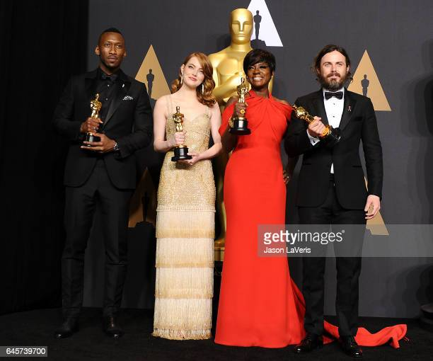 Actors Mahershala Ali Emma Stone Viola Davis and Casey Affleck pose in the press room at the 89th annual Academy Awards at Hollywood Highland Center...