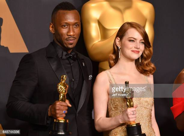 Actors Mahershala Ali winner of Best Supporting Actor for 'Moonlight' and Emma Stone winner of Best Actress for 'La La Land' pose in the press room...