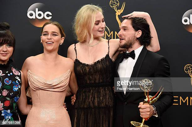 Actors Maisie Williams Emilia Clarke Sophie Turner and Kit Harington winners of Best Drama Series for 'Game of Thrones' pose in the press room during...