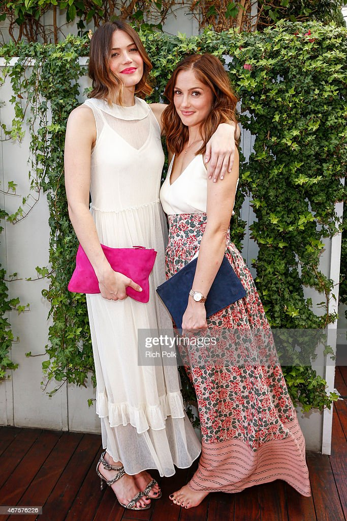 Actors Mandy Moore and Minka Kelly pose for a photo at an event where Minka Kelly launches a bag line with fashionABLE to create jobs for women in...