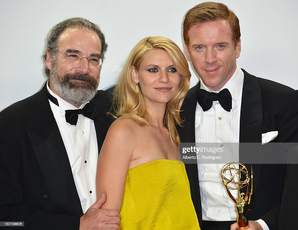 Actors Mandy Patinkin, Claire Danes and Damian Lewis pose in the 64th Annual Emmy Awards press room at Nokia Theatre L.A. Live on September 23, 2012 in Los Angeles, California.