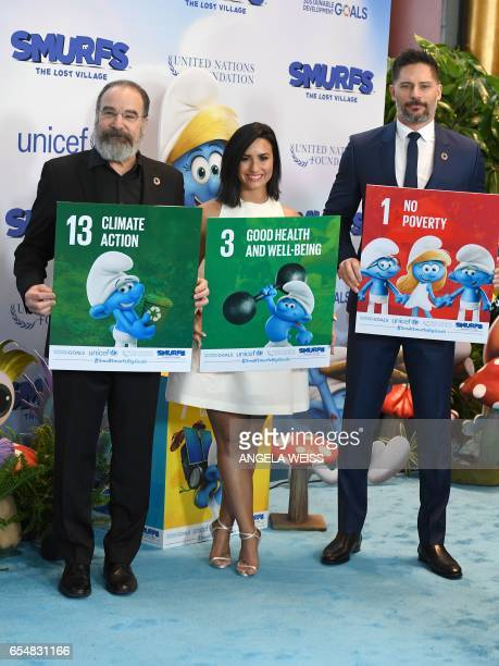 Actors Mandy Patinkin Demi Lovato and Joe Manganiello attend International Day of Happiness in conjunction with SMURFS THE LOST VILLAGE at the United...