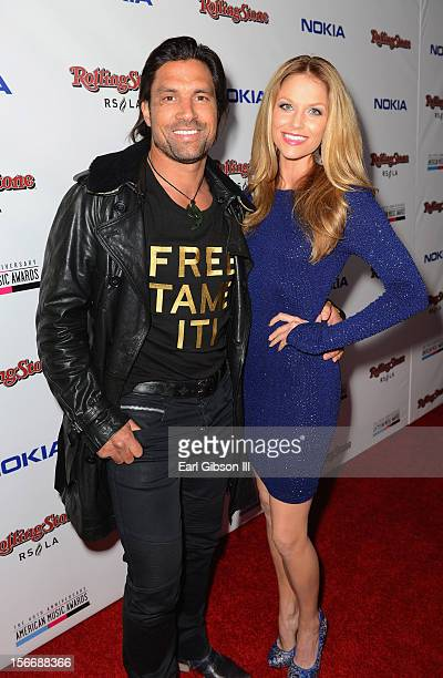 Actors Manu Bennett and Ellen Hollman arrive at Rolling Stone Magazine Official 2012 American Music Awards VIP After Party presented by Nokia and...