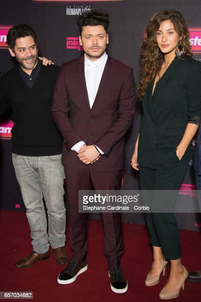 Actors Manu Payet Kev Adams and Manon Azem attend the 'Gangsterdam' Paris Premiere at Le Grand Rex on March 23 2017 in Paris France
