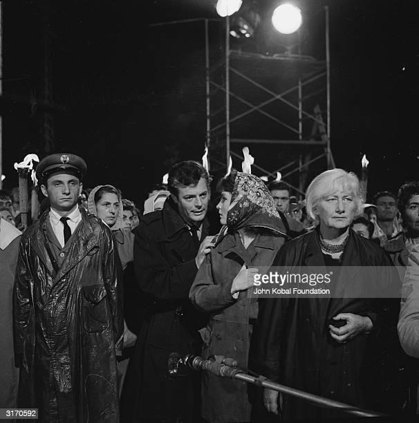 Actors Marcello Mastroianni and Yvonne Furneaux film the miracle scene for 'La Dolce Vita' directed by Federico Fellini