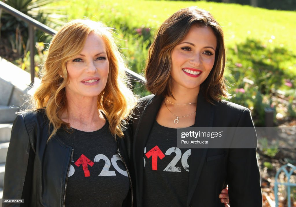 Actors Marg Helgenberger (L) and Italia Ricci (R) attend the 'Stand Up To Cancer' press conference at Los Angeles City Hall on August 27, 2014 in Los Angeles, California.