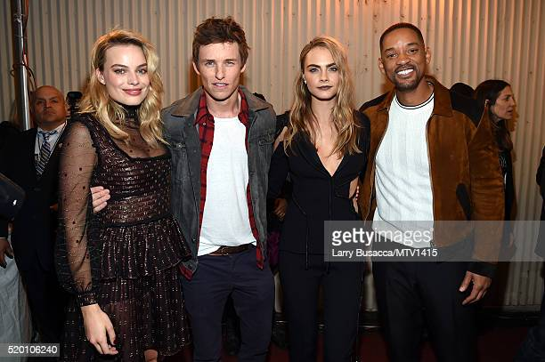 Actors Margot Robbie Eddie Redmayne model/actress Cara Delevingne and honoree Will Smith attend the 2016 MTV Movie Awards at Warner Bros Studios on...