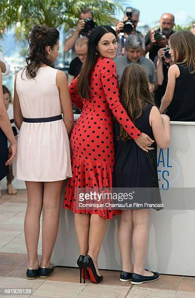 Actors Maria Alexandra Lungu Monica Bellucci and MariaStella Morrow attend 'The Wonders' photocall at the 67th Annual Cannes Film Festival on May 18...
