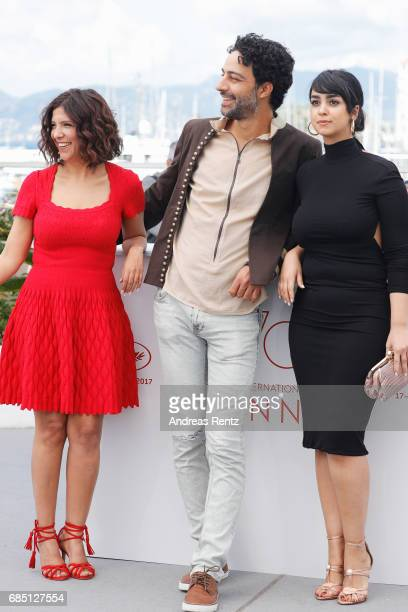 Actors Mariam Al Ferjani Ghanem Zrelli and director Kaouther Ben Hania attend 'Alaka Kaf Ifrit ' Photocall during the 70th annual Cannes Film...