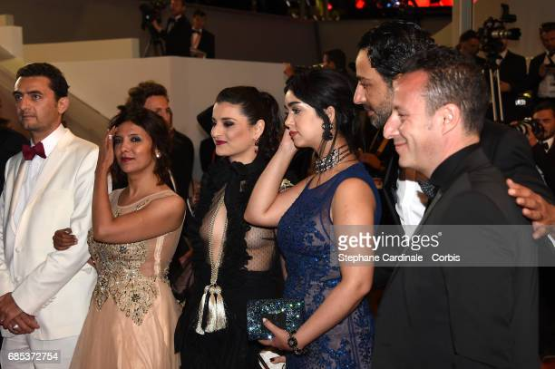 Actors Mariam Al Ferjani Ghanem Zrelli director Kaouther Ben Hania and guests from the movie 'Alaka Kaf Ifrit ' attend the 'Jupiter's Moon' screening...