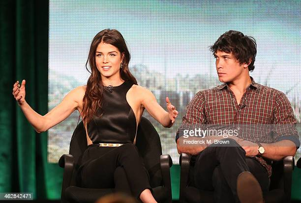 Actors Marie Avgeropoulos and Bob Morley of the television show 'The 100' speak onstage during the CW portion of the 2014 Winter TCA tour at the...