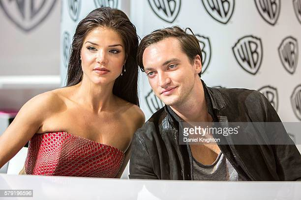Actors Marie Avgeropoulos and Richard Harmon attend 'The 100' autograph signing at ComicCon International 2016 Day 2 on July 22 2016 in San Diego...