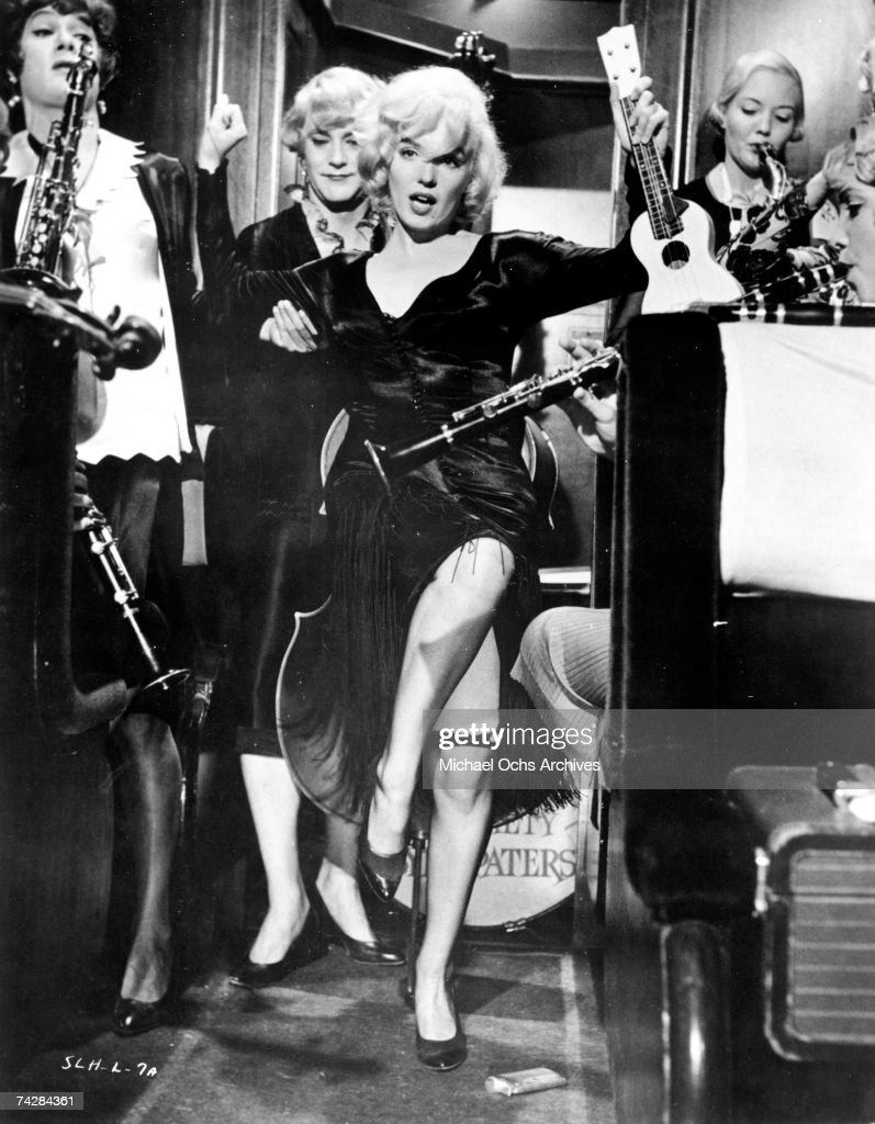 Actors <a gi-track='captionPersonalityLinkClicked' href=/galleries/search?phrase=Marilyn+Monroe&family=editorial&specificpeople=70021 ng-click='$event.stopPropagation()'>Marilyn Monroe</a>, Jack Lemmon and Tony Curtis perform a scene from the movie 'Some Like It Hot' directed by Billy Wilder and released March 29, 1959. 'Some Like It Hot' won an Academy Award for Best Costume Design.