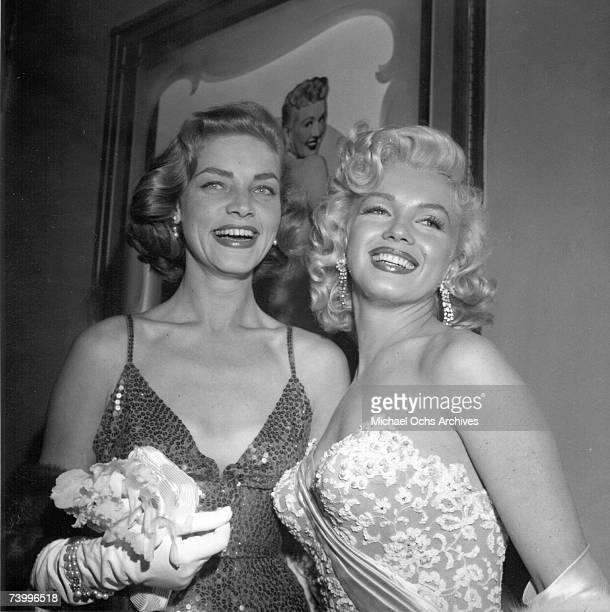 Actors Marilyn Monroe Lauren Bacall and Humphrey Bogart attend the premiere of the movie 'How To Marry A Millionaire' with a guest on November 4 1953...
