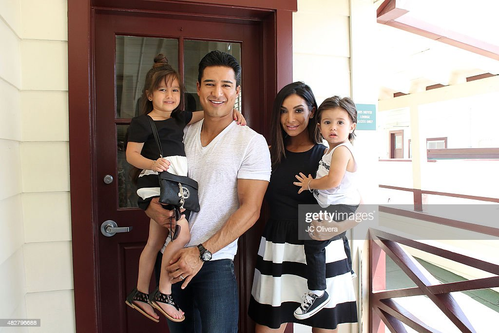 Actors <a gi-track='captionPersonalityLinkClicked' href=/galleries/search?phrase=Mario+Lopez&family=editorial&specificpeople=235992 ng-click='$event.stopPropagation()'>Mario Lopez</a>, <a gi-track='captionPersonalityLinkClicked' href=/galleries/search?phrase=Courtney+Mazza&family=editorial&specificpeople=5650960 ng-click='$event.stopPropagation()'>Courtney Mazza</a> and their children Gia and Dominic attend L.A. Parent's 35th birthday bash at Original Farmers Market on August 2, 2015 in Los Angeles, California.