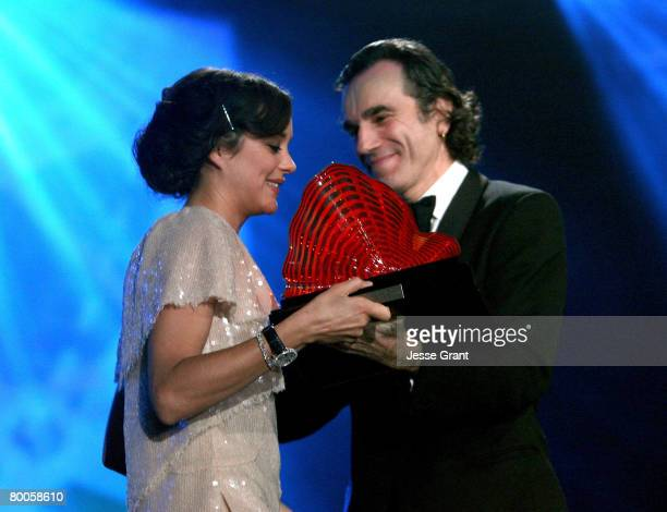 Actors Marion Cotillard and Daniel DayLewis at The 19th Annual Palm Springs International Film Festival Awards Gala presented by Cartier held at the...