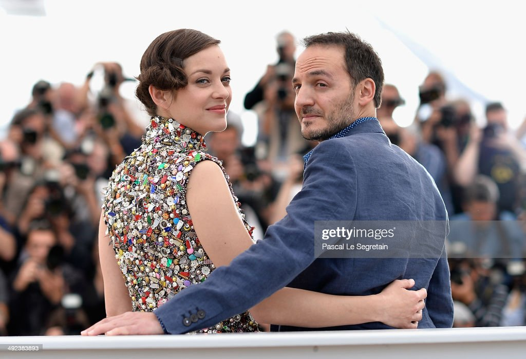 Actors <a gi-track='captionPersonalityLinkClicked' href=/galleries/search?phrase=Marion+Cotillard&family=editorial&specificpeople=215303 ng-click='$event.stopPropagation()'>Marion Cotillard</a> and <a gi-track='captionPersonalityLinkClicked' href=/galleries/search?phrase=Fabrizio+Rongione&family=editorial&specificpeople=5349599 ng-click='$event.stopPropagation()'>Fabrizio Rongione</a> attend the 'Two Days, One Night' (Deux Jours, Une Nuit) photocall during the 67th Annual Cannes Film Festival on May 20, 2014 in Cannes, France.