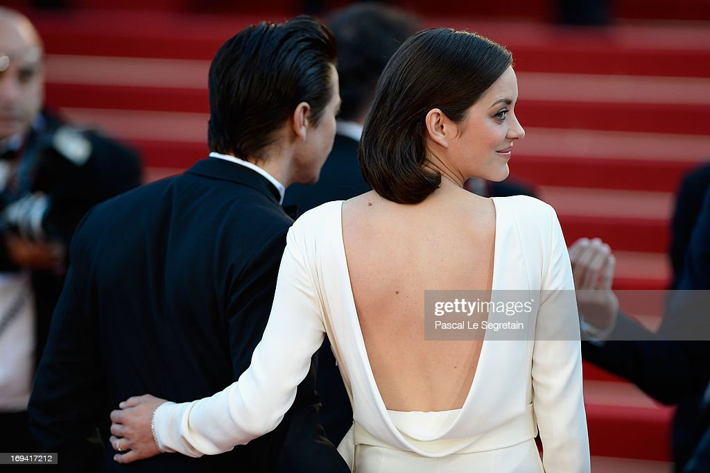 Actors Marion Cotillard and Jeremy Renner attend the 'The Immigrant' premiere during The 66th Annual Cannes Film Festival at the Palais des Festivals on May 24, 2013 in Cannes, France.