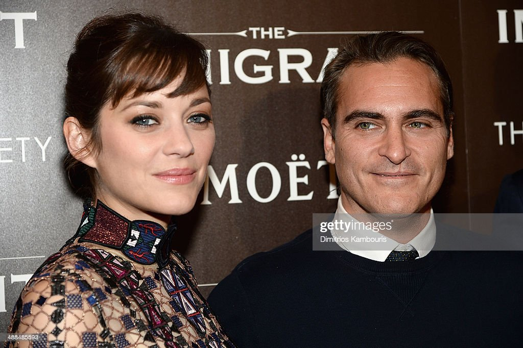 Actors <a gi-track='captionPersonalityLinkClicked' href=/galleries/search?phrase=Marion+Cotillard&family=editorial&specificpeople=215303 ng-click='$event.stopPropagation()'>Marion Cotillard</a> (L) and <a gi-track='captionPersonalityLinkClicked' href=/galleries/search?phrase=Joaquin+Phoenix&family=editorial&specificpeople=215391 ng-click='$event.stopPropagation()'>Joaquin Phoenix</a> attend the Dior & Vanity Fair with The Cinema Society premiere of The Weinstein Company's 'The Immigrant' at The Paley Center for Media on May 6, 2014 in New York City.