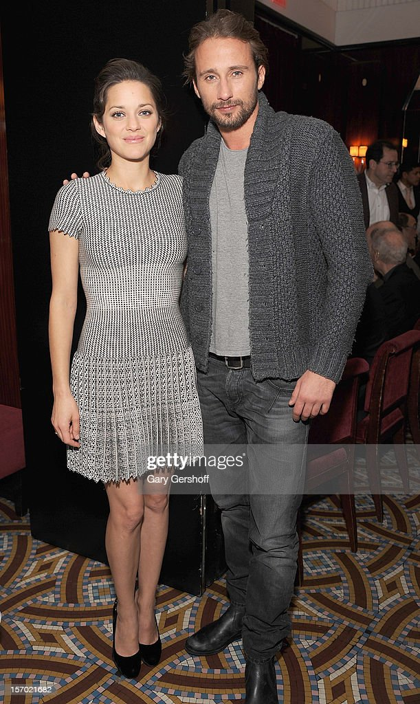 Actors <a gi-track='captionPersonalityLinkClicked' href=/galleries/search?phrase=Marion+Cotillard&family=editorial&specificpeople=215303 ng-click='$event.stopPropagation()'>Marion Cotillard</a> (L) and <a gi-track='captionPersonalityLinkClicked' href=/galleries/search?phrase=Matthias+Schoenaerts&family=editorial&specificpeople=6259320 ng-click='$event.stopPropagation()'>Matthias Schoenaerts</a> attend the 'Rust And Bone' Luncheon at Brasserie Ruhlmann on November 27, 2012 in New York City.