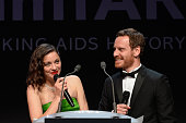 Actors Marion Cotillard and Michael Fassbender onstage during amfAR's 22nd Cinema Against AIDS Gala Presented By Bold Films And Harry Winston at...