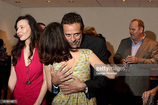 Actors Marisa Tomei and Alexander Siddig hug at the 'Inescapable' Premiere during the 2012 Toronto International Film Festival at Roy Thomson Hall on...