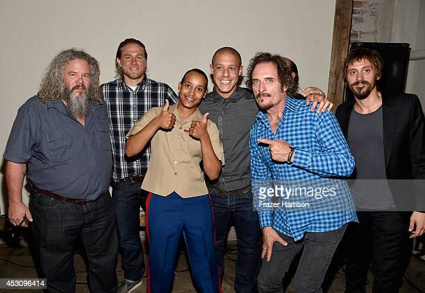 Actors Mark Boone Junior Charlie Hunnam Theo Rossi Kim Coates and Niko Nicotera pose with guest at Cast of FX's 'Sons of Anarchy' Host 'Boot Bash'...