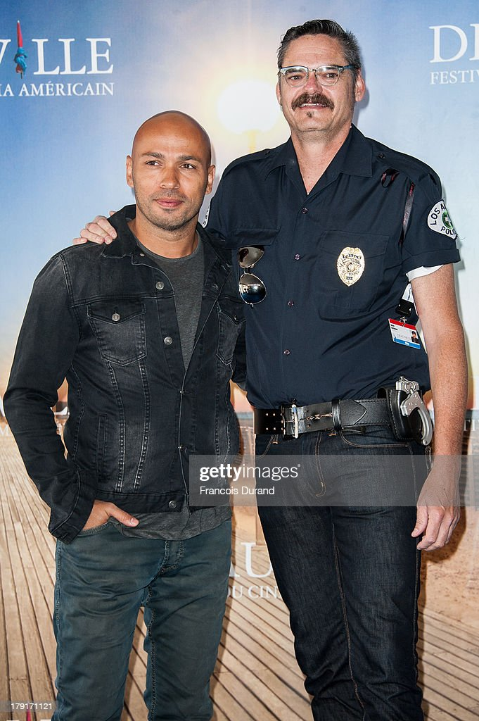 Actors Mark Burnham (R) and Eric Judor pose during a photocall for the film 'Wrong Cops' on September 1, 2013 in Deauville, France.