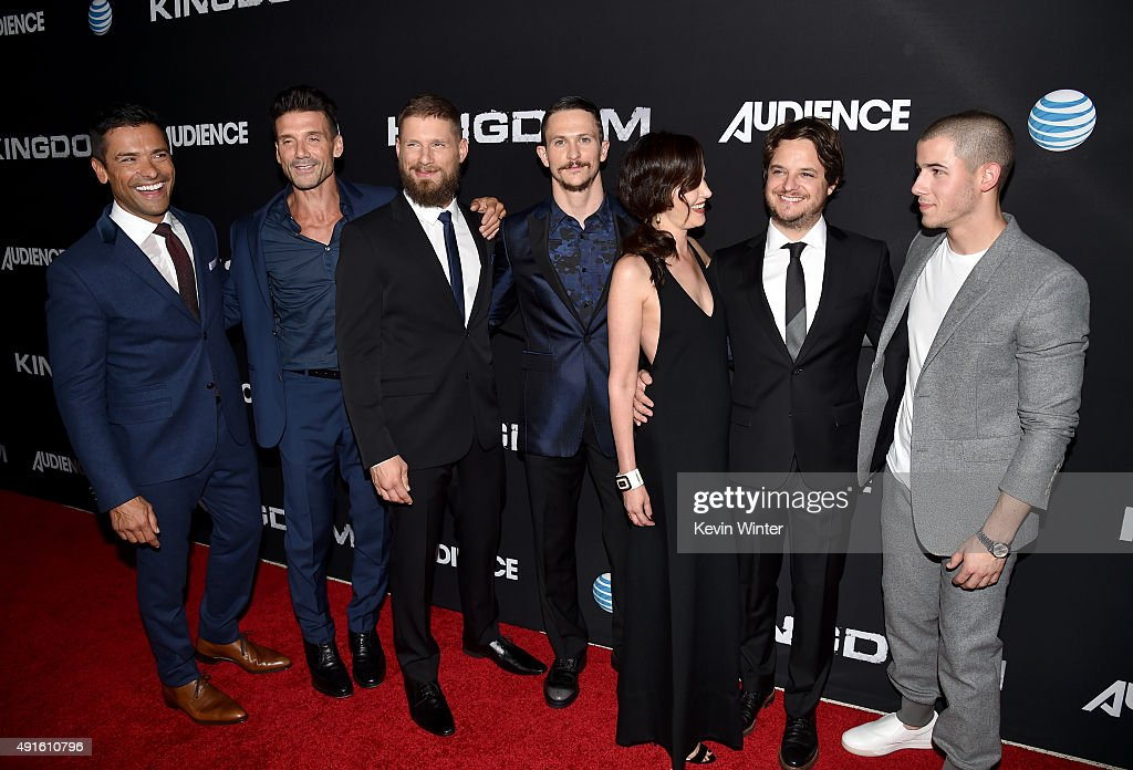 Actors Mark Consuelos, Frank Grillo, Matt Lauria, Jonathan Tucker, Joanna Going, creator/EP Byron Balasco, and singer/actor Nick Jonas attend the premiere of DIRECTV's 'Kingdom' Season 2 at SilverScreen Theater at the Pacific Design Center on October 6, 2015 in West Hollywood, California.