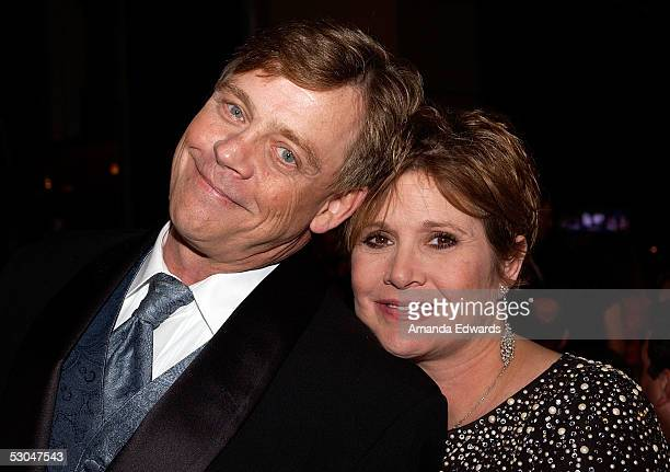 Actors Mark Hamill and Carrie Fisher pose at the dinner during the 33rd AFI Life Achievement Award tribute to George Lucas at the Kodak Theatre on...