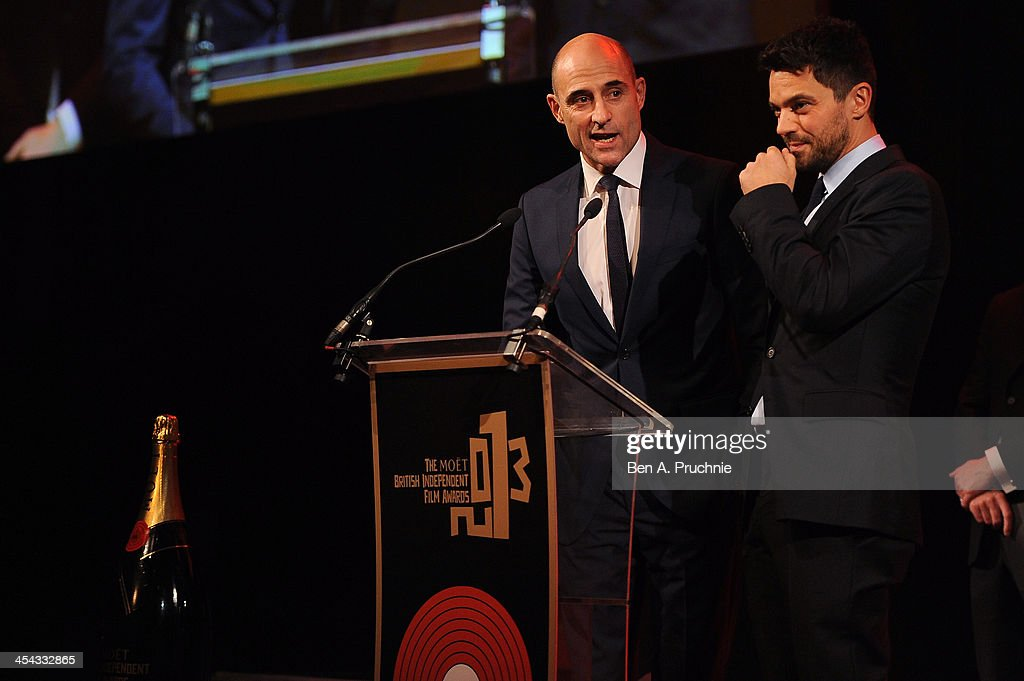 Actors Mark Strong (L) and Dominic Cooper present the award for Best Actress as they attend the ceremony for the Moet British Independent Film Awards at Old Billingsgate Market on December 8, 2013 in London, England.