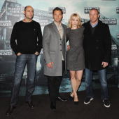 Actors Mark Strong Jude Law Rachel McAdams and director Guy Ritchie attend 'Sherlock Holmes' photocall at Cinema Gaumont Marignan on January 15 2010...