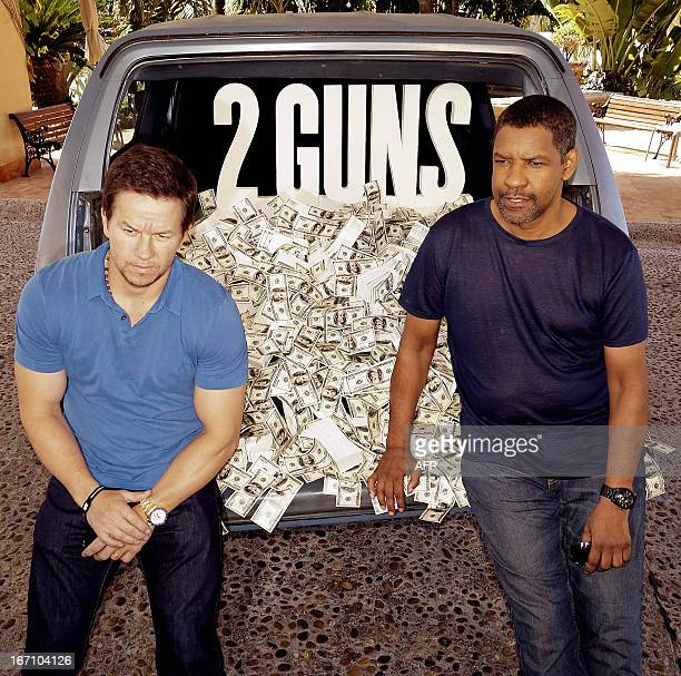 US actors Mark Wahlberg and Denzel Wahington pose during a photo opportunity while arriving to the presentation of their movie '2 Guns' in the...